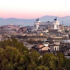 The evening descends in delicate colors on the city of Rome and we enjoy the wonderful view from Castel Sant'Angelo, the Pantheon dome, the Vittoriano and the Capitol (left to right). Behind the Alban Hills. #italy #rome #castelsantangelo #pantheon #vittoriano #capitol #panorama #view #sunset #travel #citytour
