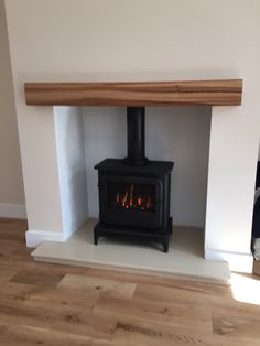 Hole in the wall fire place with oak beam.