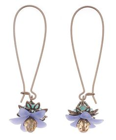Stacked lucite flowers and antique brass make for an explosively pretty pair of floral dangles.
