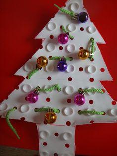 Threading mini christmas baubles onto a precut christmas tree bathmatt