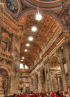 St. Peter's Basilica in Rome, Italy.  Rich architectural details include paintings, statues, reliefs, carvings, and marble designs.