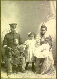 Unidentified portrait of a Tenth Cavalry soldier and his family, by A. W. Baumman, Crawford, Nebraska, about 1904.