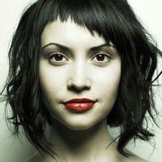 short wavy hair with asymmetrical bangs.