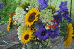 Sunflowers and blue and white messy flower arrangements :)