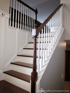 From carpet and honey oak to crisp white and dark stain.  GORGEOUS!  And I can totally do this.