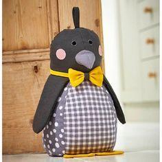 peso de porta patchwork de pinguim