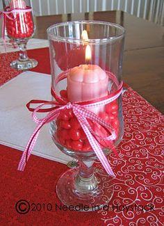 Cute centerpiece idea- red hots and votive in a hurricane glass