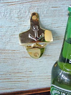 If your boat, beach house, or coastal home bar is where you choose to hang with a cold one, this opener is just what the bottle ordered. Made of cast brass, it's adorned with a nickel-plated anchor in the center, just fitting for the nautical enthusiast. Made to provide years of use, it's a reliable bar-time accessory.  Two holes for mounting, brass mounting screws included.