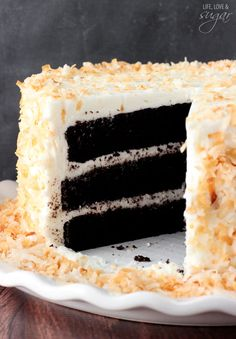 Coconut Cake Chocolate Coconut Cake - super moist and chocolatey cake paired with coconut icing and toasted coconut! To die for!Chocolate Coconut Cake - super moist and chocolatey cake paired with coconut icing and toasted coconut! To die for!
