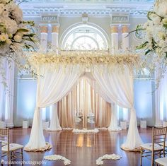 I like that golden curtain in addition to the white. We don't need all the flowers on top, although it is beautiful!