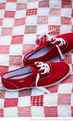 red Keds and red & white patchwork quilt