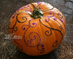 Last year on the cover of BH&G Halloween magazine there was an elegant be-jeweled pumpkin that I just loved. I searched everywhere for adhes...