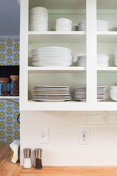 Lining your cabinets is a must. It will mask worn and grungy cabinets without having to paint. Adhesive liner works, but a softer grip liner is better because it's easy to install; it will also prevent glassware from chipping.