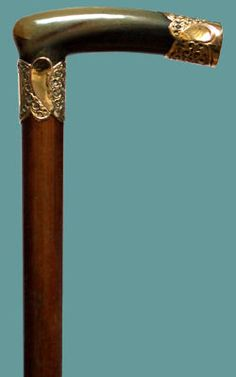 "Horn and Rolled Gold on Malacca, circa 1890. The length is 35"". Full length view."