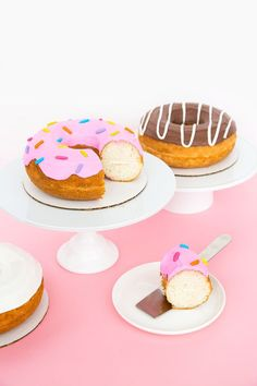 Did we fool you?! These donuts are actually CAKES!! We haven't done a donut-related project on here in a while and I've been meaning to whip out my donut cake pan again (the last time we used them was