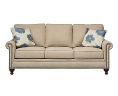 Chartres Sofa by CORT (shown with blue and yellow flowered pillows) | cort.com