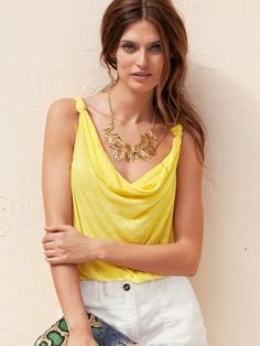 large necklace with yellow shirt...her hair color is fantastic for summer too