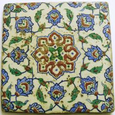 Tile. Made of polychrome painted pottery.