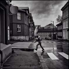 Not even close to Henri Cartier-Bresson, but he was in my mind when I captured this boy getting over the puddle. Captured at Kampen, Oslo.