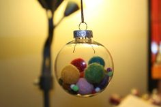 Clear plastic ornament with needle felted balls