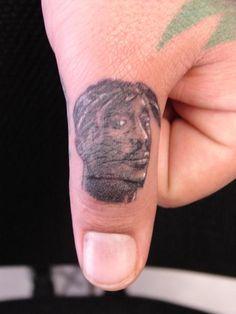 tupac finger tat