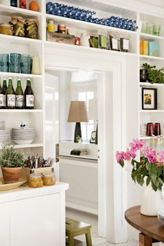 """Great use of surface space: shallow open shelving. What I want the wall between """"new"""" dining room and mudroom/laundry will hopefully look like."""