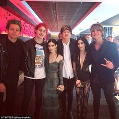 Reunited: The Veronicas posed with the boys from 5 Seconds of Summer, who they supported o...