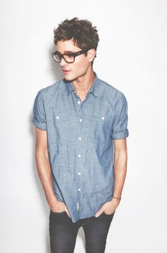 Oversized tortoise shell glasses and chambray shirt