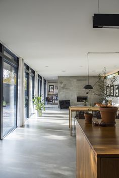 Polished concrete floors, black aluminium window frames and timber.
