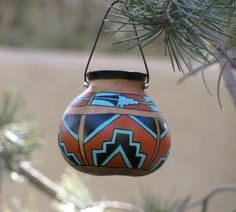 Hey, I found this really awesome Etsy listing at https://www.etsy.com/listing/165518595/southwestern-hand-painted-gourd-pot