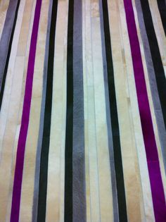 "Edelman Leather ""barcode"" cowhide rug in many colors."