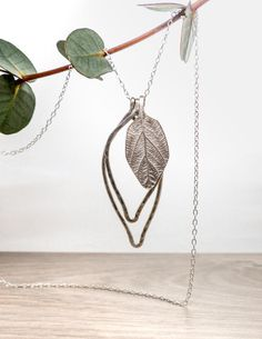 Be the envy of your friends with this stunning botanical necklace. It is a large silver leaf necklace with a very elegant modern minimal style. This lovely nature necklace has three large silver leaves of different sizes hung on a sterling silver chain. Two of the leaves are made using