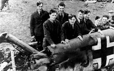 Allied military & locals pose w/the remains of Messerschmitt ME-110 after it crash-landed near the Scottish village of Eaglesham. The flight to Scotland catapulted Hess' name outside Germany & into the headlines. The Nuremberg trials kept it there for a while. But interest in the fate of Rudolf Hess faded in the postwar years except for the persistent efforts of his son to get him freed.