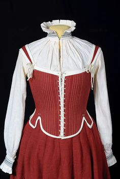 Pair of bodies worn over a high-necked smock - note the bodies are low and very wide, with adjustable straps - so they can be worn with very low-cut gowns ;)