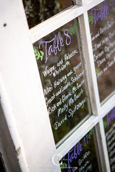 Hand lettered table assignments on a vintage glass pane door #cedarwoodweddings Wood and Flowers :: Rachel+Chris   Cedarwood Weddings
