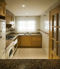 Marina d'Or Apartamentos - Cocina Stacked Washer Dryer, Washer And Dryer, Kitchen Cabinets, Home Appliances, Home Decor, Apartment Kitchen, Apartments, House Appliances, Decoration Home