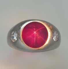Fine Burma Star Ruby of 8 carats with diamonds in platinum.