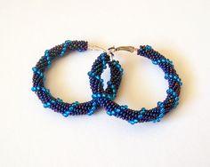 Beaded irridescent blue hoop earrings - Beadwork  earrings- beaded jewelry - seed beads earrings - big hoop earrings, modern earrings by lutita on Etsy https://www.etsy.com/listing/182269592/beaded-irridescent-blue-hoop-earrings