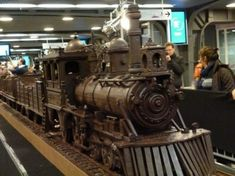 World's longest chocolate | Andrew Farrugia a chocolate artist from Malta spent more than 700 hours to built the train that measures 34 meters in length. Features every detail of a classic steam-powered train, made of the finest Belgian chocolate and weights 1250 kilograms.