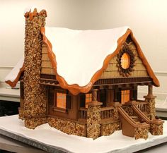 Cool Gingerbread cabin details: stone work, front porch stairs, gable, roof line Gingerbread House Designs, Gingerbread House Parties, Gingerbread Village, Christmas Gingerbread House, Gingerbread Cookies, Gingerbread House Template, Cabin Christmas, Christmas Houses, Christmas Baking