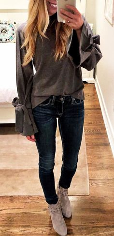 #fall #outfits women's gray long-sleeve blouse, faded blue skinny jeans, and gray suede booties