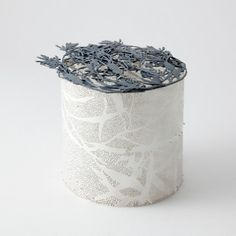 Marian Hosking - Banksia Vessel-Brooch, silver, 2011  Marian Hosking makes small boxes, with lids which may also be worn as jewellery.