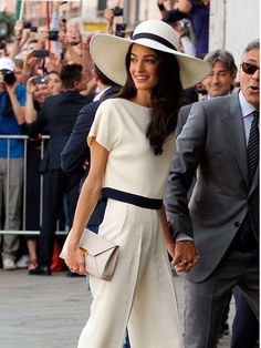 Amal wears Stella McCartney for her civil service wedding ceremony to George Clooney in Italy, September 2014.