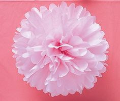 How to Make Tissue Paper Pom Poms. Surprisingly easy and ridiculously cheap to make!