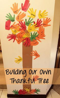 """Would be cute just for a """"fall"""" hallway display - have the kiddos paint the trunk of the tree, then trace hands with colored paper or have them make the leaves with handprints in colored paint."""