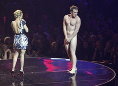 A streaker appears on stage with actress Hayden Panettiere at the MTV Europe Music Awards show in Belfast November 6, 2011.