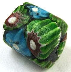 Old RARE Turquoise Green Cane Millefiori Venetian Glass African Trade Bead | This is a great bead from my collection. AN OLD RARE BARREL SHAPE BEAUTIFUL TURQUOISE BLUE, GREEN, AND RED COLOR CANE PATTERN MILLEFIORI VENETIAN GLASS AFRICAN TRADE BEAD.