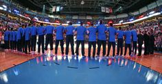 Thunder players lock arms together during the national anthem before a preseason NBA basketball game between the Oklahoma City Thunder and the New Orleans Pelicans at Chesapeake Energy Arena in Oklahoma City, Friday, Oct. 6, 2017. Photo by Nate Billings, The Oklahoman
