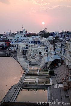 Photo about This is an aerial shot of Pushkar lake Rajasthan India during a dramatic sunset. Image of foothills, lake, clouds - 70733519 Rajasthan India, Airplane View, Shots, Clouds, Stock Photos, Sunset, Image, Sunsets, Delhi India