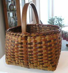 tall (including handle) x deep (basket).Antique Cherokee Indian River Cane Egg Basket w/ Oak Handle, Awesome Patina ::: Gorgeous Basket, Wish I had a Cherokee Basket. Cane Baskets, Old Baskets, Pine Needle Baskets, Vintage Baskets, Wicker Baskets, Woven Baskets, Bountiful Baskets, Sisal, Native American Baskets
